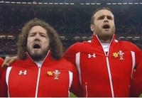 Picture of a Welsh Forward and Back singing the Welsh national anthem in full voice